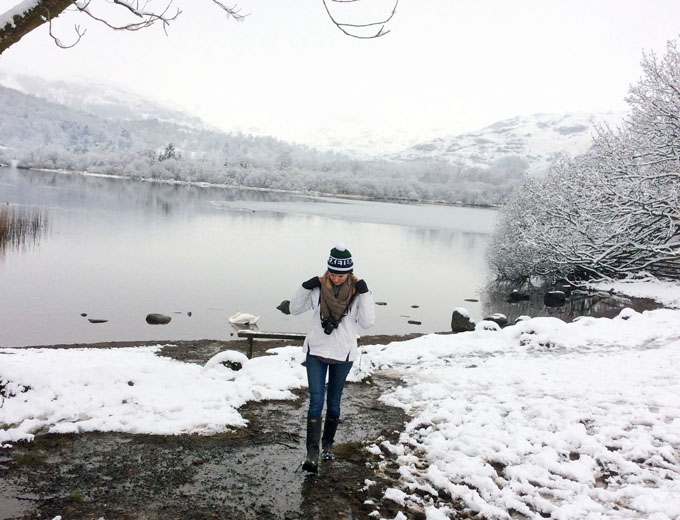 Snowy lake and girl in the English Lake District